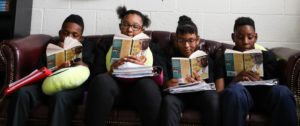 Aspire Memphis Students reading on a couch together